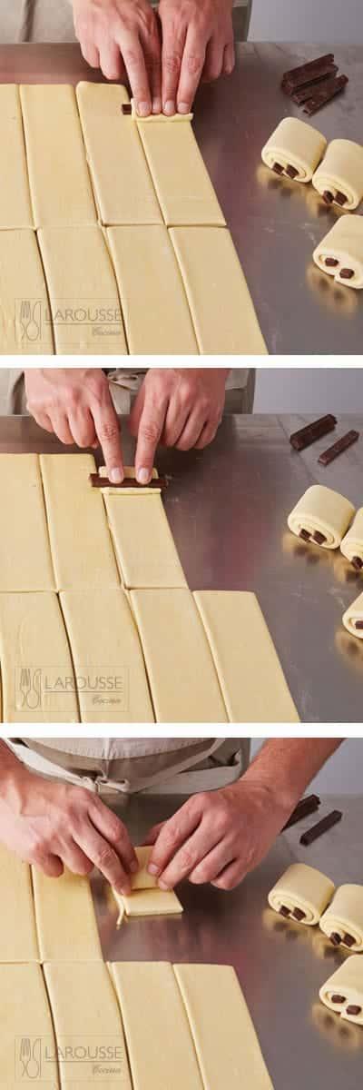 <p>Ponga una barra de chocolate a lo largo de la base de un rectángulo de masa, dejando un espacio de 2 centímetros entre la orilla y el chocolate. Enrolle el rectángulo sobre sí mismo para envolver la barra de chocolate y presione toda la orilla del doblez con los dedos; coloque enseguida otra barra de chocolate y continúe enrollando hasta llegar al final del rectángulo. Repita este paso con el resto de los rectángulos.</p>